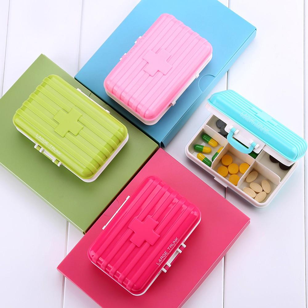 Mini suitcase shaped pill box