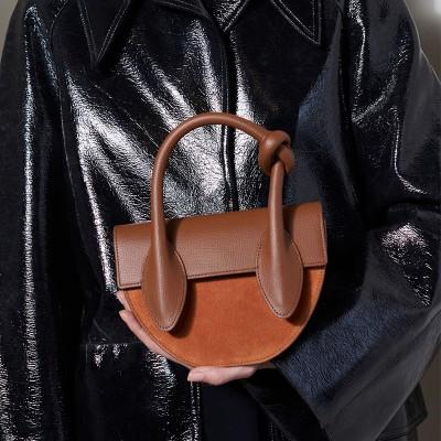 Bag 2020 early spring new niche design personality semicircular handbag simple wild hit color female bag